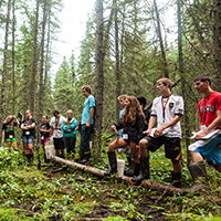 Photo of students standing in forest