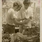 Edward Leete and student in greenhouse, 1972