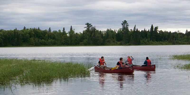 Students canoeing on Lake Itasca