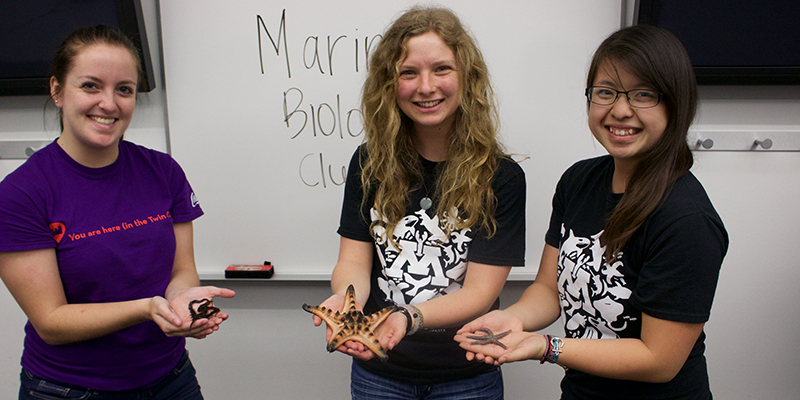 Marine Biology Club students pose with critters