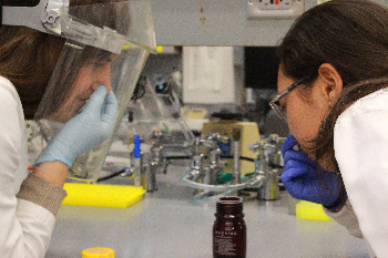 Lien Phung and Megan McCarthy joking around in the lab