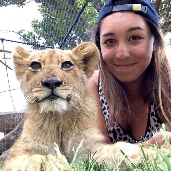 Ana with a lion cub