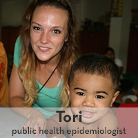 Photo of Tori Cowger, 2012 graduate, with small child